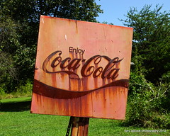 Enjoy Coca-Cola (tonyadcockphotos) Tags: sign store rust rusty cocacola oldsign countrystore rustysign cokesign enjoycocacola sal1650f28