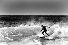 Surf's up (julian fraser photography) Tags: ocean sea blackandwhite bw beach mono waves surfer surfing surfboard 70300mm suf catchawave d700 ridethatwave