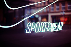 Sportswear (andersdenkend) Tags: show city light urban window sign reflections shopping advertising neon dof bokeh famous tubes artificial nike depthoffield fluorescent laser vignetting lasershow available brands sportswear neonlicht neonrhren nikkor50mmf12 nisen nikond700