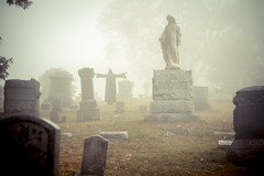 No escaping the ultimate silencer (Piouscat/C.Quinn) Tags: cemetery grave graveyard statue fog angel scary gates antique foggy graves spooky mummy markers gravestones grimreaper irongate canon60d