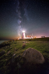 Obsessed (moe chen) Tags: ocean lighthouse seascape water grass rock night bench way bristol point landscape star maine boulder astral milky beacon pemaquid