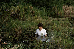 Man in Swamp (Karolis Milasevicius) Tags: portrait green water iso200 moss nikon 85mm tshirt swamp f18 lithuania d3 alienbees labadiena photoshoocom