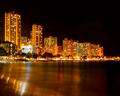 Waikiki at Night (Mary Susan Smith) Tags: travel vacation buildings reflections hawaii holidays cityscape nightshot waikiki oahu superhero honolulu thumbsup bigmomma gamewinner challengeyouwinner 3waychallengewinner cychallengewinner thechallengefactory tcfwinner tcfunanimouswinner yourockwinner thumbsupchallengeswinner tcfultimategrind herowinner ultraherowinner storybookwinner