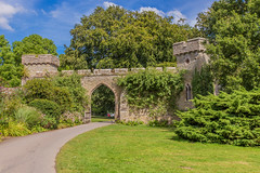 The Gateway (microwyred) Tags: grass forestwoods landscape nt church blueskys croftcastle landscapes places towers tree gate wildflowers