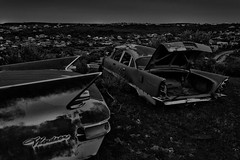 the endless junkyard at night. 2015. (eyetwist) Tags: eyetwistkevinballuff eyetwist junkyard cold dark night longexposure long exposure clouds overcast desert nikon nikond7000 d7000 nikkor capturenx2 1024mmf3545g tripod npy nocturne highdesert roadside america americana americantypology landscape vast endless graveyard nik silver efex niksilverefex alienskin plugins post processed bw blackwhite black white monochrome dead empty wasteland shadows abandoned ruin desolate lonely car cars autos vintage classic field horizon rust rusty junk wrecked derelict decay idaho goat west tailfins fins windsor chrysler trunk autoanthropology carmageddon apocalypse