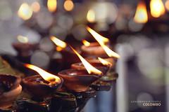 light it up (Juavenita ) Tags: oillamp gangaramayatemple flame lamp