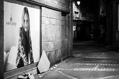 On the other side (Lasorigin) Tags: noirblanc stmalo street sujet urbanpicture advertising shadow light lightroom france night alley blackwhite publicit rue lumire nuit sombre canon eos 100d 50mm pavment trottoir sidewalk