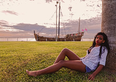 Nias (Cardwell Photo LLC | Thanks for 2 Million Views!) Tags: backlighting backlit bay beautiful beauty blue bluehour bluejeanshorts bluejeans boat brown clouds colorful corpuschristi corpuschristimarina dawn faded fashion girl green jasminepahmiyer jazzminerain jazzmyne leaning marina model nina nuecescounty outdoor ppl palm palmtree people pink plants portrait sailboat sea ship shore shorts sit sitting sky sunrise teen texas tree vehicle warm woman yellow caravel grass horizontal unitedstates