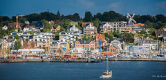 2016 - Baltic Cruise - Kiel Germany - Sunny Side Laboe (Ted's photos - For Me & You) Tags: 2016 balticcruise cropped tedmcgrath tedsphotos vignetting laboe laboegermany marina germany buildings windmill crane constructioncranes water sailboat waterfront