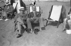 Relaxing on the beach (vintage ladies) Tags: blackandwhite vintage photo photograph man male hat hats pipe smoking sleeping sunglasses deckchair deckchairs feet tie suit portrait people