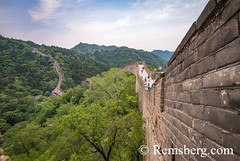Mutianyu, China - Landscape view of tourists taking pictures and walking on the Great Wall of China. The wall stretches over 6,000 mountainous kilometers east to west across North China and through 15 provinces. (Remsberg Photos) Tags: asia china mutianyu eastasia beijing greatwall world greatwallofchina wonderoftheworld mountains architecture photography travel destination nature internationallandmark brick builtstructure ancient history protection culture fortifiedstructure province landscape beauty tourists chn