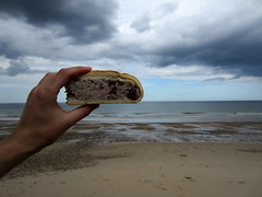 Sausage slice on the horizon (CisPos) Tags: chris sky beach rain pie norfolk thepoint gatheringstorm