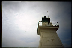 light of Port Dover (Beaulawrence) Tags: auto camera summer lighthouse lake toronto ontario canada color colour film june clouds analog port point lomo lomography shoot pentax kodak grain lofi slide mini eerie automatic to pocket ektachrome e6 dover ont 2012 vigneting reversal espio 100vs sooc