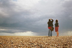 sunshine on a rainy day (lomokev) Tags: portrait england sky people beach clouds photography nikon brighton cloudy kodak unitedkingdom stones 35ti nikon35ti
