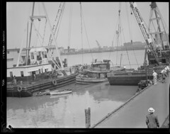 """Pulling up sunken tug """"Eileen Ross"""" at T-Wharf (Boston Public Library) Tags: maritime tugboat towboat pierswharves lesliejones twharf marineaccidents rosstowboat eileenross"""