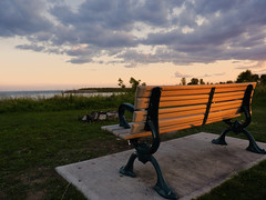 Enjoy the view.. (Jaggy89) Tags: sunset toronto canada bench lakeontario