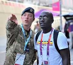 RAF Serviceman Providing Assistance During the Olympic Games (Defence Images) Tags: uk man male coach military games security arena directions british olympic uganda olympics directing defense assisting defence raf helping cpl corporal wembley jnco personnel guiding london2012 royalairforce craignicholls identifiable