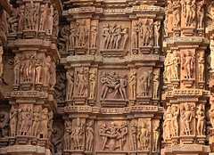 INDIA - Khajuraho Group of Monuments is a group of about 20  Hindu and Jain temples, erotic reliefs and sculptures,  14234/7101 (roba66) Tags: madhya pradesh khajuraho tempel tempelanlage temple hinduism jainism indien indiennord asien asia india inde northernindia urlaub reisen travel explore voyages visit tourism roba66 city capital stadt cityscape building architektur architecture arquitetura monument bau fassade faade platz places historie history historic historical geschichte tradition culture kultur kulturdenkmal sexual sexual practices erotic chandela kamasutra indienkhajurahotempel