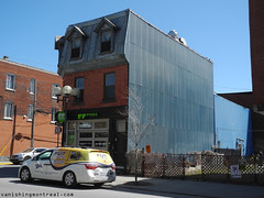 Narrow building on Notre-Dame (Vanishing Montral) Tags: history villedemontreal montreal histoire photography art architecture demolition disappearinghistory newconstruction