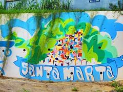 Bullet holes riddle a graffiti wall at Santa Marta Favela in Rio de Janeiro (Jcwanderlust) Tags: santamarta favela riodejaneiro