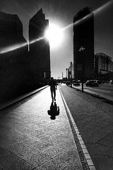 Lone troop in Berlin Streetphotography Street Photography Streetphoto_bw Monochrome Light And Shadow Silhouette Building Exterior Street Architecture Road City Lens Flare Outdoors Light And Dark On The Road On The Move Sunlight Sunlight And Shadow Travel (Eugene Kong) Tags: streetphotography streetphotobw monochrome lightandshadow silhouette buildingexterior street architecture road city lensflare outdoors lightanddark ontheroad onthemove sunlight sunlightandshadow travelphotography skyscraper berlin postdamerplatz blackandwhite alone mood
