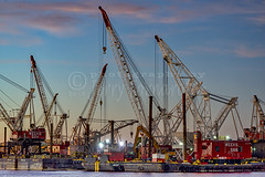 Cranes (Jerry Fornarotto) Tags: barges boat building construction crane cranes docks dusk engineering equipment evening harbor heavy industry jerryfornarotto jerseycity lift lifting machinery maritime newjersey outdoors powerful sunset towercrane wm wharf