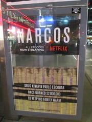 Narcos Bus Shelter Pile O Money AD 5214 (Brechtbug) Tags: narcos tv show bus stop shelter ad with piles slightly singed real fake money or is it 2016 nyc 09102016 midtown manhattan new york city 49th street 7th ave st avenue moola bogus