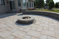 Rivenstone firepit patio (bretmarlandscape) Tags: brick landscape backyard landscaping patio entertainment seating pillars firepit landscaper landscapedesign seatwall landscapearchitect unilock bretmarlandscape