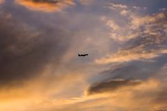 the Red Eye (flippers) Tags: road sunset vacation sky usa holiday clouds america plane cowboy unitedstates jet roadtrip jackson western rodeo wyoming jacksonhole jumbo