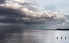 Rain sweeping in (jerryms) Tags: uk sea seascape rain clouds scotland day scenic olympus east land 18 dunbar 45mm omd lothian em5 scenicsnotjustlandscapes