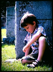 Mourning (~Bella189) Tags: people cemetery death sitting sad mourning olympus sit seated bigmomma gamewinner matchpointwinner yourockwinner agcgwinner gamex2winner herowinner ultraherowinner gamex3winner olympustg820