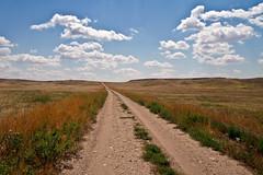 Badlands National Park, South Dakota (-dangler) Tags: park travel summer usa nature landscape outside outdoors midwest day interior south scenic sunny crosscountry national 7d geography badlands dakota 2012 dandangler pwpartlycloudy