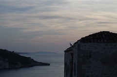 the seagull and its world (SS) Tags: camera blue light sea summer vacation sky italy white black building water weather june clouds composition photography paint mood peace dof view angle pentax pov walk seagull perspective scenic gimp railway panoramica vista framing tones bianco depth vastness k5 celeste gargano peschici costaadriatica immensit