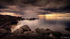 Calm Before the Storm (Geinis) Tags: ocean longexposure sunset sea sky cloud seascape storm beach nature colors weather stone clouds canon photography iceland rocks heaven sundown stones rocky sigma stormy calm beatiful sland 2012 peacful icelandic canon500d