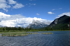 Mount Rundle (Patricia Henschen) Tags: park trees lake canada mountains clouds rockies drive lakes rocky canadian national alberta banff roadside northern larch mountrundle vermilion banffnationalpark vermilionlakes