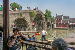 the call - (stevefge (away for a few days)) Tags: china shanghai zhujiaujiau watertown people women bridges water telephone boats candid street summer reflectyourworld