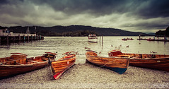 Boats on Windermere I (Nathan Dodsworth Photography) Tags: windermere lakedistrict england tourists boating water lakes wildlife lights sky trees reflections shoreline pier jetty swans geese mood atmospheric tranquility mooring rowing boats people