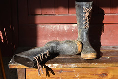 On the farm, s, Akershus (lacafferata) Tags: boots steps rainboots workboots rubberboots bootlaces blackboots shadows redbarn morninglight laces muddyboots