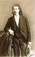 Buffalo Bill in formal wear instead of his usual buckskins.  Exhibit at the Buffalo Bill Museum on Lookout Mountain, Colorado (lhboudreau) Tags: buffalobill buffalobillmuseum museum lookoutmountain colorado usa williamfcody williamfbuffalobillcody cody buffalobillcody exhibit beard mustache williamfrederickcody formalwear publicityphoto tuxedo formalattire 1870s youngman longhair suit monochrome blackandwhite cane hat formaldressclothes