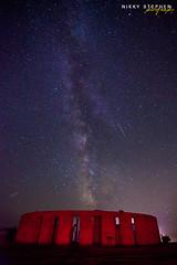 Perseids at Maryhill Stonehenge (djniks) Tags: red night stars shower washington memorial replica stonehenge wa nightsky meteor perseidsmeteorshower milkyway maryhill canon1740f4 perseids maryhillstonehenge canon5dmkii redstonehenge