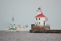 Integrity leaves Superior Entry, WI (JonWayneMI) Tags: lighthouse minnesota wisconsin boat lakesuperior freighter