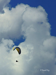 Paragliders ~Matt Davis and the Giant in the Clouds~ (Ron1535) Tags: golden colorado wing sail roll pitch soaring glider paraglider lookoutmountain thermals mtzion yaw cloudformations freeflying freeflight paragliderpilot windcurrents flexiblewing glideraircraft soaringaircraft ramairdesign