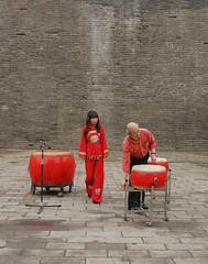 Getting Ready for Drum Show - Xian (China) (Esther Spektor) Tags: show china travel red vacation music woman man history yellow stone wall tile grey back beige drum percussion culture folklore xian drumming tradition citywall couryard drumshow cplor estherspektor