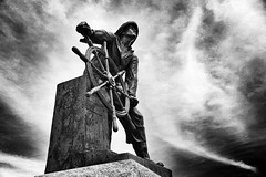 Man at the wheel and those behind him (c. Melon Images) Tags: summer bw statue contrast fisherman memorial fishermen gloucester 2012 capeann snapseed