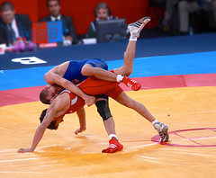 Peter Modos (Hungary) and Hamid Mohammad Soryan Reihanpour (Iran) (Michael N Hayes) Tags: london roman wrestling 2012 olympicgames greco london2012 londonolympics olympicwrestling grecoromanwrestling petermodos hamidmohammadsoryanreihanpour