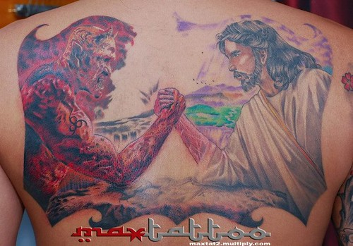God And The Devil Arm Wrestling Tattoo