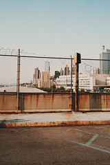 (brian james) Tags: new york nyc newyorkcity usa newyork film skyline america 35mm fence buildings pier skyscrapers manhattan 4th july views barbedwire brianjames cz today barbed policestate corruption murca brianjamesphotography briankip httpbrianjamesphotographynet httpbrianjamesphototumblrcom viewonamericatoday