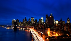 NYC Blue (DPGold Photos) Tags: nyc travel bridge blue light ny newyork building skyline river downtown cityscape manhattan brooklynbridge manhattanbridge eastriver lighttrails bluehour streaks fdrdrive dpgoldphotos