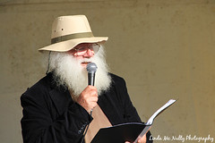 Poetry Reading by Mike Absalom (linda_mcnulty) Tags: ireland musician white man senior hat beard grey reading book poetry artist oldman read poet microphone mayo mic westport speech bigbeard harpist whitebeard westporthouse