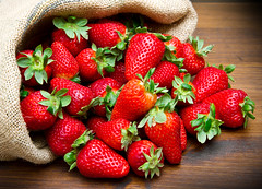 fresh strawberry in burlap sack on wood (derrickbrutel) Tags: wood red summer italy food green fruit leaf healthy strawberry berry shiny raw sweet vibrant group vivid tasty fresh seeds delicious slice sack ripe burlapsack